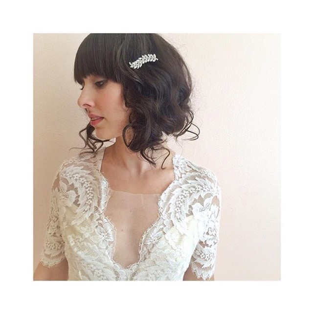 Short curly bob hairstyle for wedding