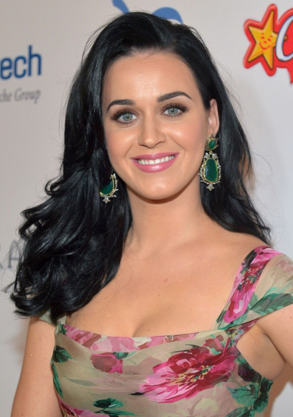 Katy Perry long black wavy hairstyle for oval faces