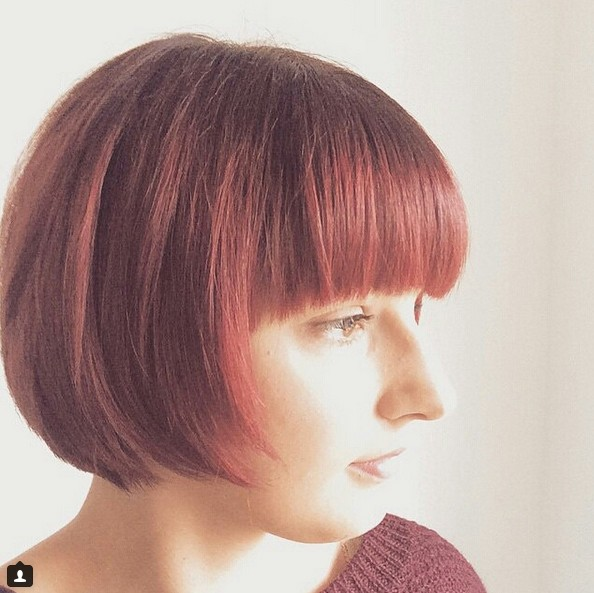 cute short red bob haircut with blunt bangs