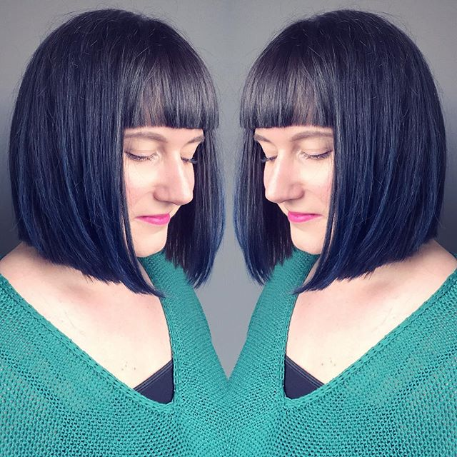 short dark blunt bob hairstyle with blunt bangs for women over 40