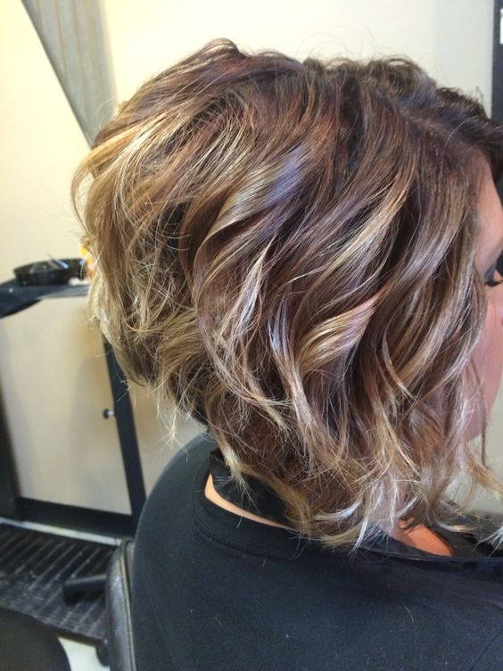 short curly stacked haircut
